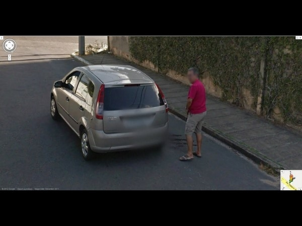 Man Peeing on a Car