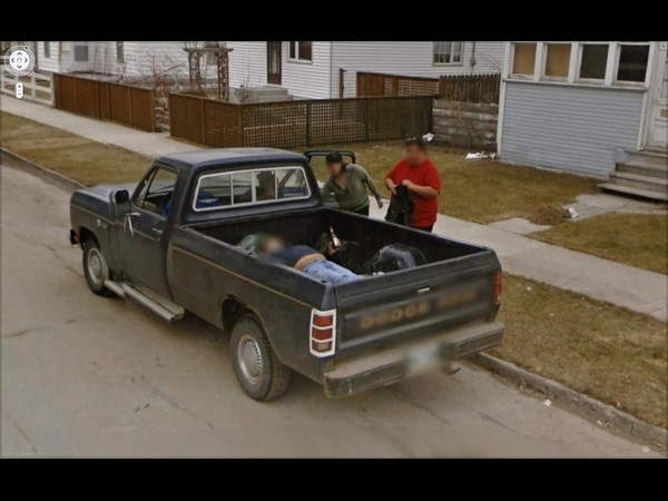 Man Drinking Beer and Lying in a Truck Bed