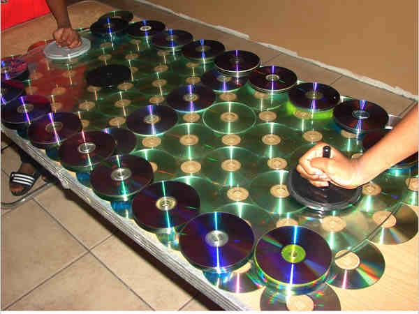 Air hockey table with CDs